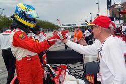Pole winner Sébastien Bourdais celebrates with Paul Newman