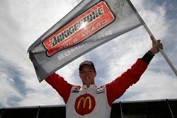 Sébastien Bourdais celebrates winning the pole position