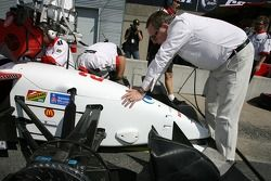 Carl Haas helps his team