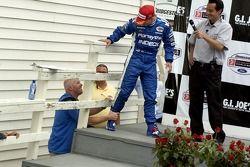 Victory podium: Paul Tracy congratulates A.J Allmendinger