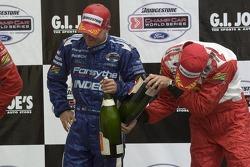 Victory podium: A.J. Allmendinger and Sébastien Bourdais