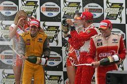 Podium: champagne for Sébastien Bourdais, Cristiano da Matta and Justin Wilson