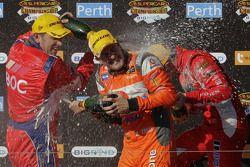 Podium: race winner Jamie Whincup celebrates with Jason Bright and Garth Tander