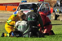 Karl Reindler being assisted by rescue teams following his fireball crash