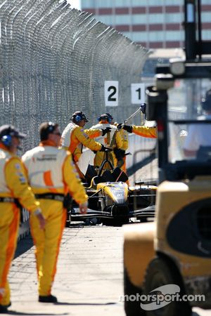 Champ Car safety crew at work on the crashed car of Katherine Legge