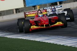 Sébastien Bourdais and Paul Tracy race out of turn 11