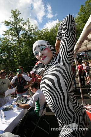 Acrobats entertain the fans at the autograph session