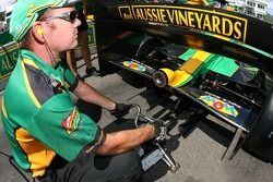 Team Australia crew member fires up the car