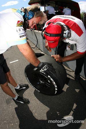 Bridgestone technician takes tire temperature