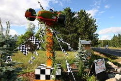 A race car made of flowers as a welcome sign