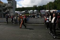 Minardi Team USA crew members celebrate while waiting for race winner Robert Doornbos
