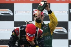 Podium: champagne for Robert Doornbos and Will Power