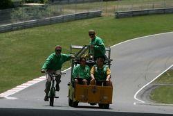 Team Australia crew members drive around the track