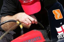 Minardi Team USA team member at work