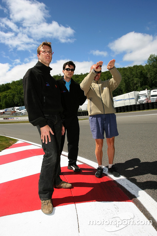 Sébastien Bourdais walks the track with Newman/Haas/Lanigan Racing crew members
