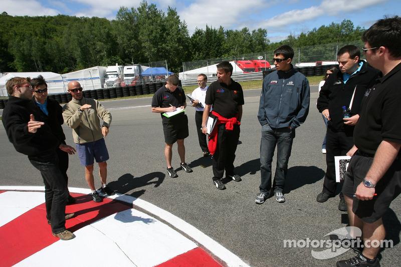 Sébastien Bourdais and Graham Rahal walk the track with Newman/Haas/Lanigan Racing crew members