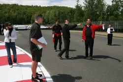 Sébastien Bourdais walks the track with Newman/Haas/Lanigan Racing crew members