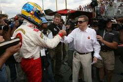 Pole winner Sébastien Bourdais celebrates with Carl Haas
