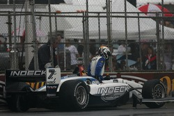 Oriol Servia gets out of his car