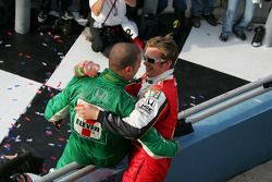 Race winner Dan Wheldon celebrates with Tony Kanaan