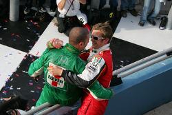 Race winner Dan Wheldon celebrates with Tony Kanaan