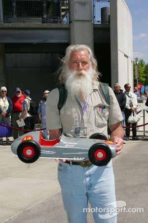 A fan shows off his vintage race car model