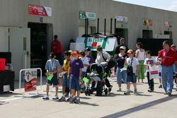 Young fans enjoy a stroll through the garage area