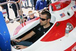 Dario Franchitti plays a racing simulator