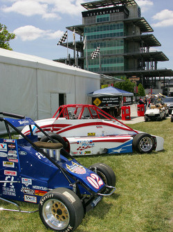 USAC race cars sit in the shadow of the Bombardier Pagoda