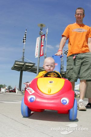 A young fan enjoys a wagon ride