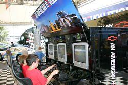 Young fans enjoy playing racing simulators