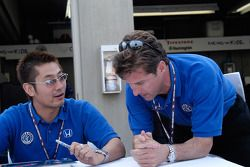 Roger Yasukawa consults with Robby Buhl