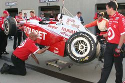 Crew members inspect the damage to Darren Manning's car