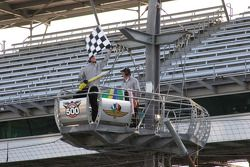 Flagman signals the end of the day's practice