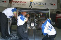 Vitor Meira's crew check to see who is watching work on the car