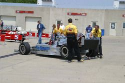 Tomas Scheckter's crew bring the car back from tech inspection