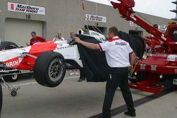 Team Penske cover Sam Hornish Jr.'s car as soon as it reaches the garage
