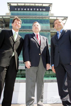Todd Harris, left, Brent Musburger, center, and Gil de Ferran in the shadow of the Bombardier Pagoda