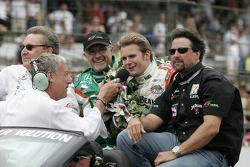Race winner Dan Wheldon takes a victory lap with Kim Green and Michael Andretti