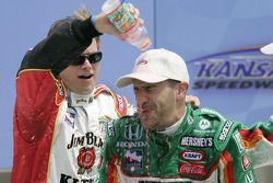 Victory lane: race winner Tony Kanaan celebrates with Dan Wheldon