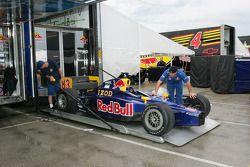 Cheever Racing crew members unpack car