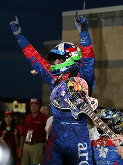 Victory lane: race winner Dario Franchitti celebrates