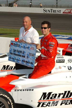 Pole winner Sam Hornish Jr. accepts check