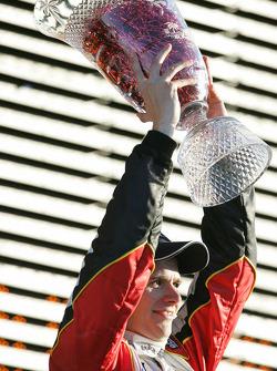 Podium: race winner Dan Wheldon celebrates