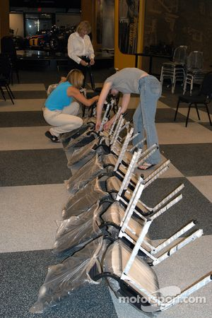 Mass unwrapping of 250 new chairs for Saturday banquet