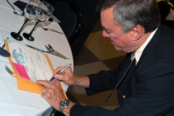 Johnny Rutherford signs as witness on marriage certificate