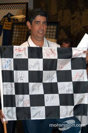 Checkered flag flown at 2005 Motegi IRL race signed by all participants up for auction