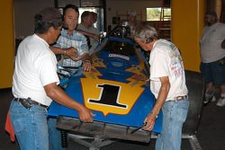 Board member Gerald Sexson assists property manager Lee Gonzales and former Galles crew chief Martin