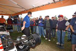 Fans watch an Indycar on display