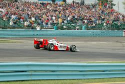 Helio Castroneves jumps to the lead